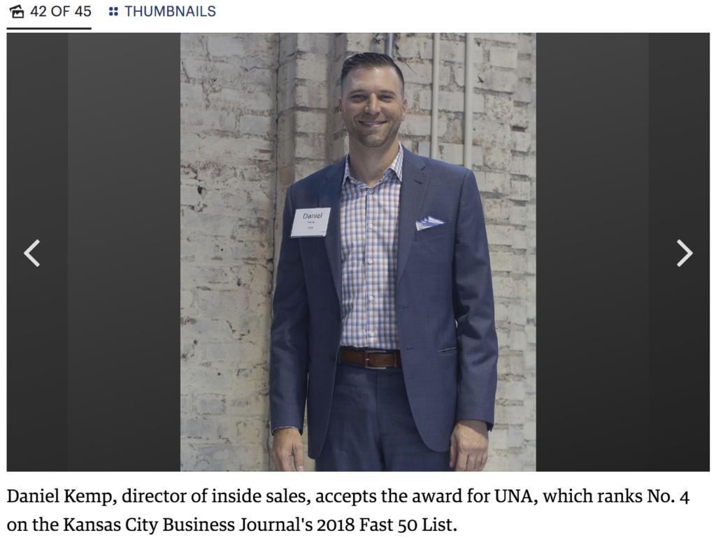 Daniel Kemp receiving the award